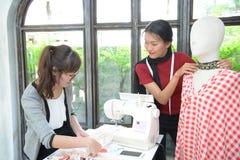 designer concept : Fashion designer working near mannequin in of Stock Photography