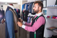 Designer is creating business image. In man store stock photo