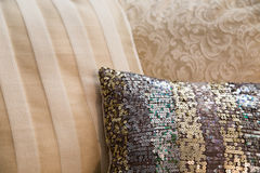 Designer cushions home decor. A variety of luxury decor cushions in beige and champagne tones with a little bling royalty free stock image