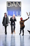 Designer Dan Liu and a dancer perform on the runway for the Dan Liu collection Royalty Free Stock Photos