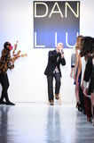 Designer Dan Liu and a dancer perform on the runway for the Dan Liu collection. NEW YORK, NY - FEBRUARY 10: Designer Dan Liu and a dancer perform on the runway Royalty Free Stock Photos