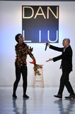 Designer Dan Liu and a dancer perform on the runway for the Dan Liu collection. NEW YORK, NY - FEBRUARY 10: Designer Dan Liu and a dancer perform on the runway Royalty Free Stock Images