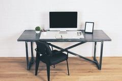Designer desk with black chair stock images