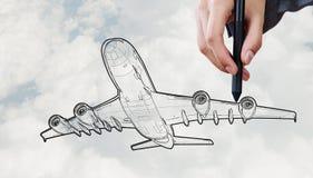 Designer draw airplane Stock Photos