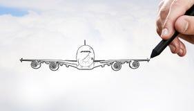 Designer draw airplane Stock Photography