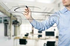 Designer draw sketch with concept car. Designer draw sketch with new concept car Stock Image
