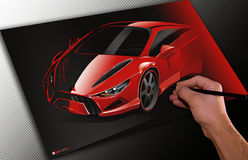 Designer drawing a car. Designer working on a drawing of his dream sports car using a stylus Royalty Free Stock Image