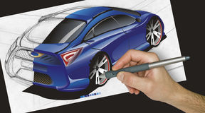 Designer drawing a car. Designer working on a drawing of his dream sports car from his perspective using a Wacom stylus pen Royalty Free Stock Images