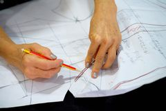 Designer is drawing  cloth pattern. Stock Photo