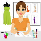 Designer drawing dress design sketches Royalty Free Stock Photos