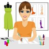 Designer drawing dress design sketches Royalty Free Stock Photos