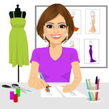 Designer drawing dress design sketches Stock Images