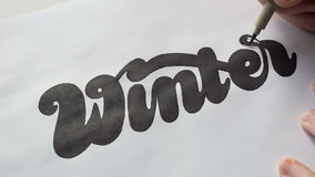Designer drawing letters with marker stock video footage