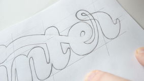 Designer drawing letters with pencil stock footage