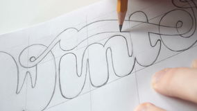 Designer drawing letters with pencil stock video