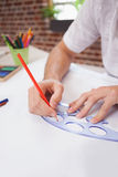 Designer drawing the old fashioned way Royalty Free Stock Photography
