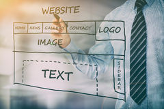 Designer drawing website development. Royalty Free Stock Photography