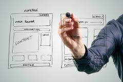 Designer drawing website development wireframe. With black marker Stock Photos