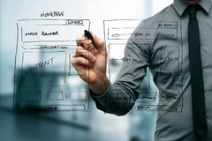 Designer drawing website development wireframe. With black marker stock photo
