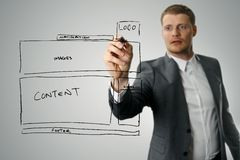 Designer drawing website development wireframe. With black marker Royalty Free Stock Photos