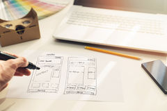 Designer drawing website development wireframe on paper royalty free stock photo