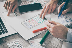 Designer drawing website ux app development. Stock Images