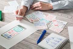 Designer drawing website ux app development. Stock Images