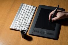 Designer Draws A Digital Pen Royalty Free Stock Photography