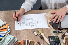 Designer draws a house design with a choice Royalty Free Stock Images
