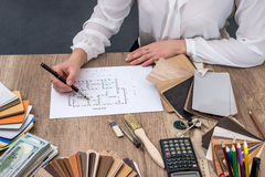Designer draws a house design with a choice Stock Image