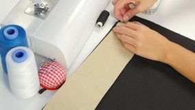 Designer draws a line on the fabric. Close up stock video