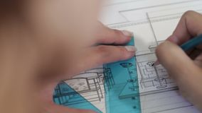 Designer draws with pencil. Hand of designer drawing the apartment stock video