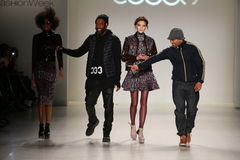 Designer Emilio Sosa walks the runway with a model in a design by Esosa at the New York Life fashion show during MBFW Fall 2015 Stock Photos