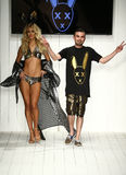Designer Eric Rosette and model walks runway during the MisterTripleX fashion show Stock Photos