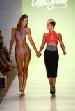 Designer Erin Thomas (R) and  model walks runway at the Toxic Sadie fashion show during MBFW Swim 2015 Royalty Free Stock Photos