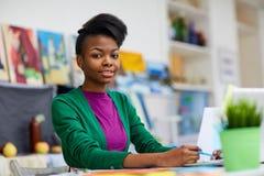 Designer of fashion. African-american designer working in fashion studio royalty free stock photography