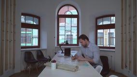 Designer focused on architectural plan . stock video