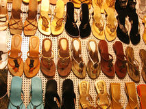 Designer Footwear. Various types and designs of ladies footwear hanging, as a background Royalty Free Stock Images