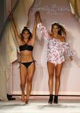Designer Francesca Aiello and model walks runway finale during the Frankies Bikinis fashion show. MIAMI, FL - JULY 18: Designer Francesca Aiello and model walks stock images