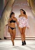 Designer Francesca Aiello and model walks runway finale during the Frankies Bikinis fashion show. MIAMI, FL - JULY 18: Designer Francesca Aiello and model walks royalty free stock photo