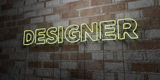 DESIGNER - Glowing Neon Sign on stonework wall - 3D rendered royalty free stock illustration Royalty Free Stock Photos