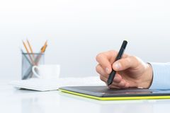 Designer hand drawing a graph on the tablet Stock Images