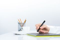 Designer hand drawing a graph on the tablet Stock Photography
