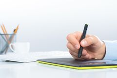 Designer hand drawing a graph on the tablet Stock Image