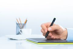 Designer hand drawing a graph on the tablet Royalty Free Stock Images