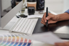 Designer. Hand of graphic designer using stylus and tablet Royalty Free Stock Images