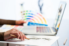 Designer hand making sketch with color chart. Stock Photos