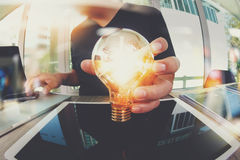 designer hand showing creative business strategy with light bulb Stock Photography