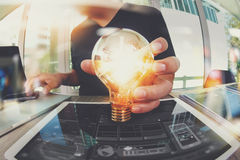 Designer hand showing creative business strategy with light bulb Royalty Free Stock Images