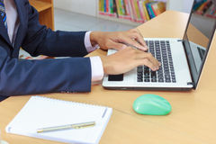 Designer hand working with digital tablet and laptop and notebook Royalty Free Stock Image